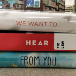 "Stack of book spines that read ""we want to hear from you"""